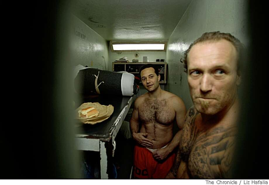 In June the prison system, including San Quentin prison will implement a U.S. Supreme Court ruling requiring the integration of inmates in double cells. Inmates David Johnson (front), from San Diego, and Michael Takis (middle), from San Jose, comment on the issue in their cell in San Rafael, Calif., on Tuesday, May 20, 2008. Photo by Liz Hafalia / The Chronicle Photo: Liz Hafalia, Chronicle