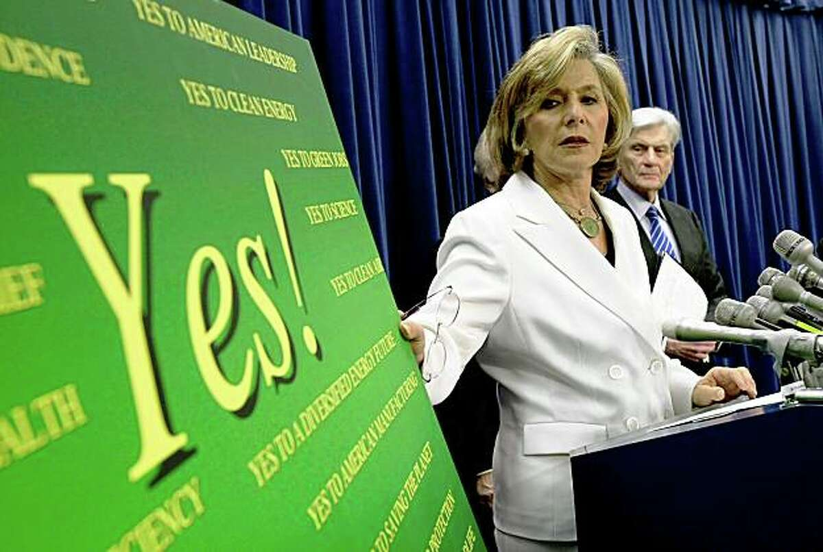WASHINGTON - JUNE 02: U.S. Sen. Barbara Boxer (D-CA) (L) speaks as Sen. John Warner (R-VA) (R) looks on during a news conference on the Climate Security Act of 2008 June 2, 2008 on Capitol Hill in Washington, DC. The Senate will vote to begin a debate on the bill this afternoon. (Photo by Alex Wong/Getty Images)