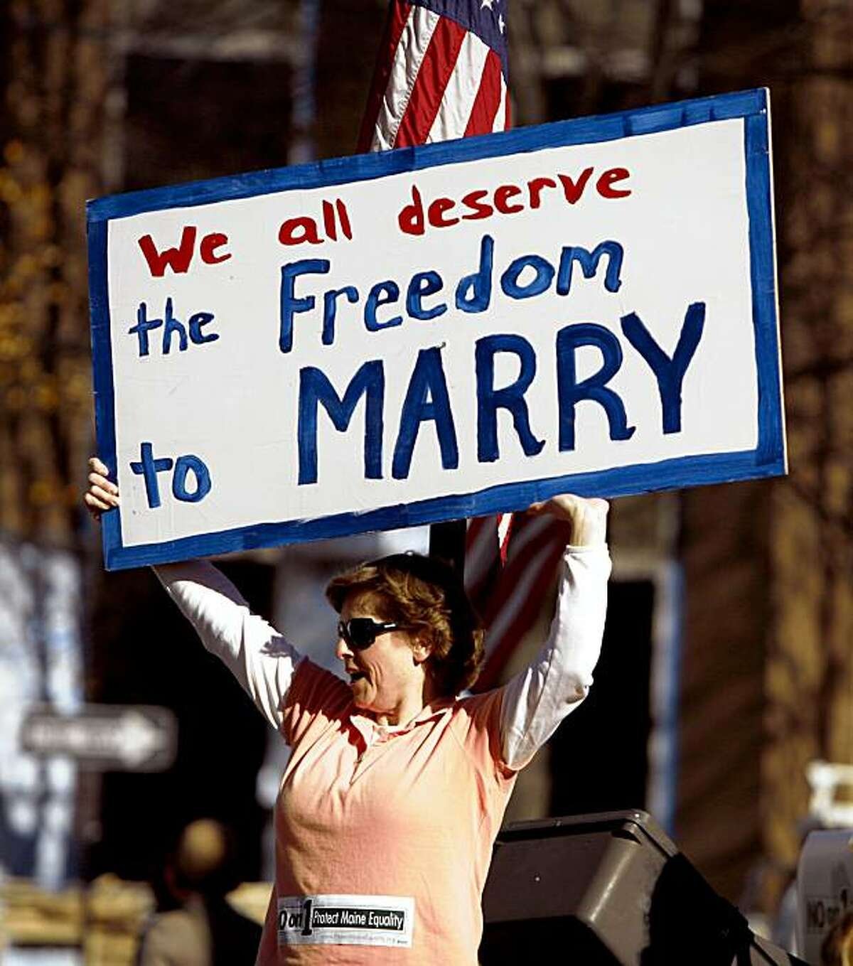 Kathy Stickel holds a sign while joining supporters who turned out for a gay-rights supporter rally the day before election day in Portland, Maine, on Monday, Nov. 2, 2009. Gay marriage has lost in every single state in which it has been put to a popular vote. Come Election Day, gay-rights supporters are hoping to make Maine the exception. (AP Photo/Pat Wellenbach)