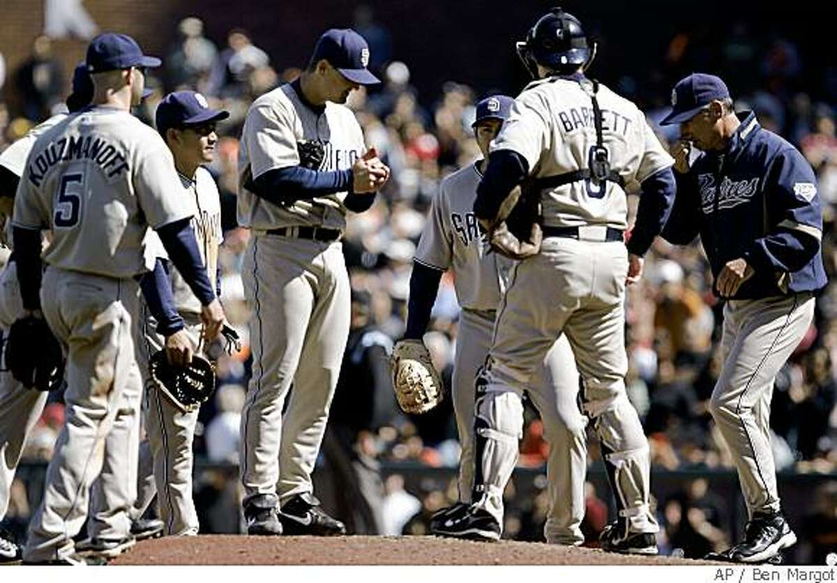 San Diego Padres' Trevor Hoffman, center, holding ball, is visited on the mound by teammates after giving up a two-run, game-tying triple to San Francisco Giants' Fred Lewis during the 10th inning of a baseball game Sunday, June 1, 2008, in San Francisco. (AP Photo/Ben Margot)