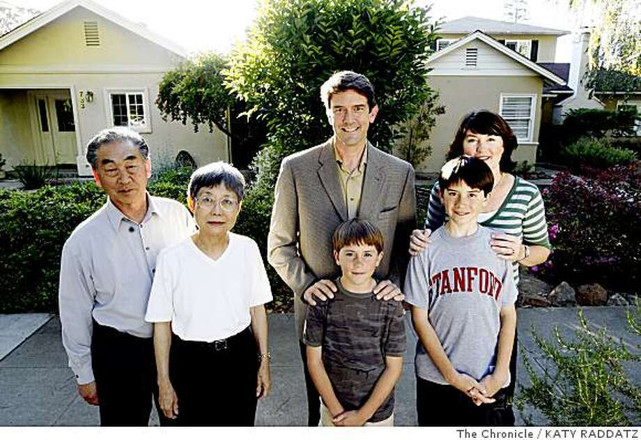 Glenn and Yoshie Kameda, left, who have lived in their home at 733 Oregon Ave.  since 1993,  Kent and Liz Libbey and their sons Hayden Libbey, 9, and Gavin Libbey, 11, have lived in their house next door at 737 Oregon Ave.  since 2008, in Palo Alto, Calif.  on Thursday June 5, 2008.Photo by Katy Raddatz / The Chronicle Photo: KATY RADDATZ, The Chronicle