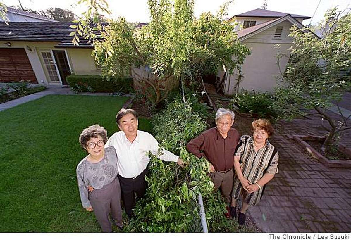Yoshie Kameda, left, Glenn Kameda, Rudy Estiva and Agnes Estiva pose for a portrait outside their Palo Alto homes on May 14, 1998. The Kameda's have lived in their home since 1993 and pay approximately $3800 in property taxes per year. The Estiva's have lived in their home since 1970 and pay approximately $800 in property taxes per year. Photo by Lea Suzuki / The Chronicle