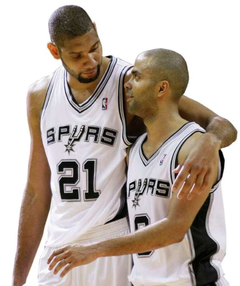 San Antonio Spurs' Tim Duncan, left, and Tony Parker, of France, talk during the second half of an NBA basketball game against the Houston Rockets, Wednesday, Feb. 1, 2012, in San Antonio. San Antonio won 99-91. Photo: Darren Abate, AP / FR115 AP