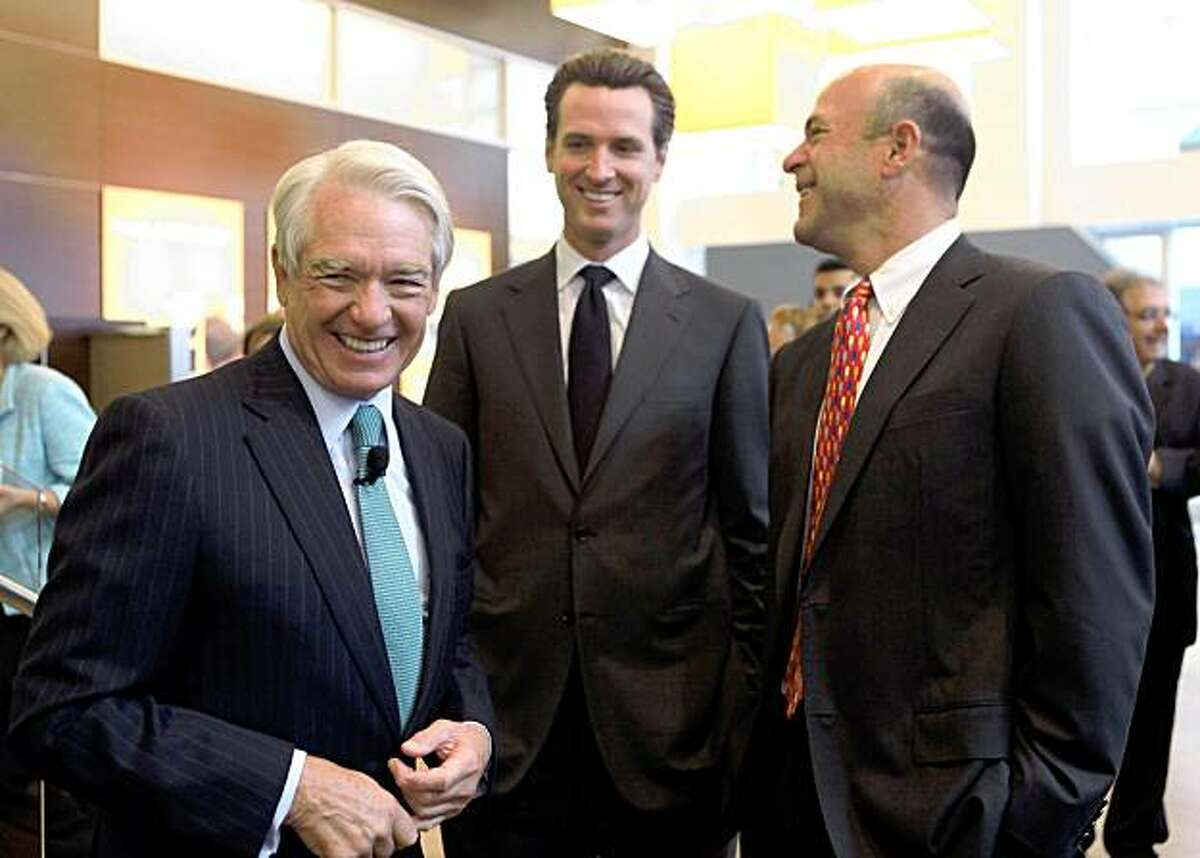 SAN FRANCISCO - OCTOBER 27: Charles Schwab Corp. founder and chairman Chuck Schwab (L) jokes with San Francisco mayor Gavin Newsom (C) and John Fisher (R) during the grand opening of the new Charles Schwab flagship branch October 27, 2009 in San Francisco, California. Charles Schwab's new 12,500 square foot flagship location will offer space for customers to work with financial consultants, check on accounts and attend workshops. (Photo by Justin Sullivan/Getty Images)