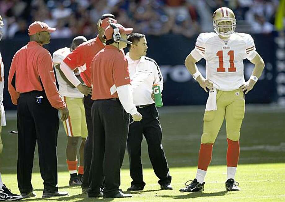 San Francisco 49ers quarterback Alex Smith (11) stands near the sidelines with the 49ers coaches during the 2nd half of an NFL football game against the Houston Texans at Reliant Stadium Sunday, Oct. 25, 2009, in Houston. The Texans beat the 49ers 24-21. ( Brett Coomer / Chronicle ) Photo: Brett Coomer, Chronicle