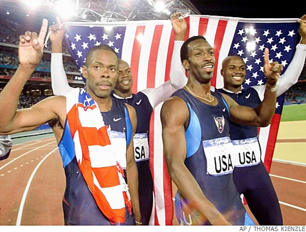 ** FILE ** In this Sept. 30, 2000 file photo, the U.S. men's 4x400-meter relay team celebrates after winning the gold medal at the Summer Olympics in Sydney. From left are, Antonio Pettigrew, Calvin Harrison, Michael Johnson and Alvin Harrison. Pettigrew for the first time has admitted taking performance-enhancing drugs. He testified ThursdayMay 22, 2008 during the trial of his former coach Trevor Graham, who is accused of lying to federal authorities investigating doping. Graham has pleaded not guilty. (AP Photo/Thomas Kienzle, File)