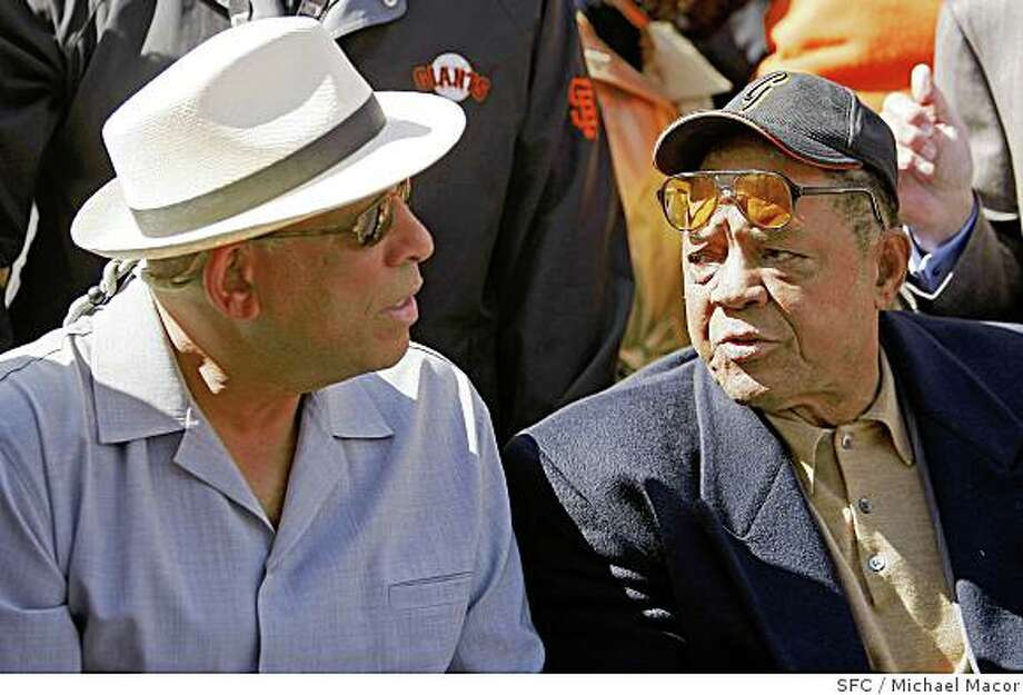 Baseball stars Orlando Cepeda, left and Willie Mays, join a crowd gathered at the corner of 16th Street and Bryant, Street,  on April 15, 2008, for a plaque dedication to honor the first pitch thrown at Seals Stadium in San Francisco, Calif.,  in 1958.Photo by  Michael Macor/ San Francisco Chronicle Photo: Michael Macor, SFC