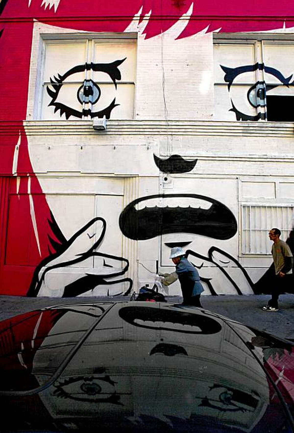 """""""Fear Head"""" a mural by Roman Cesario and Mitsu Overstreet along Golden Gate Street between Mason and Jones, on Tuesday October 27, 2009. 74 artists collaborate to create, """"Wonderland"""", 16 projects that fill sidewalks, buildings and storefronts throughout the Tenderloin in San Francisco, Calif."""