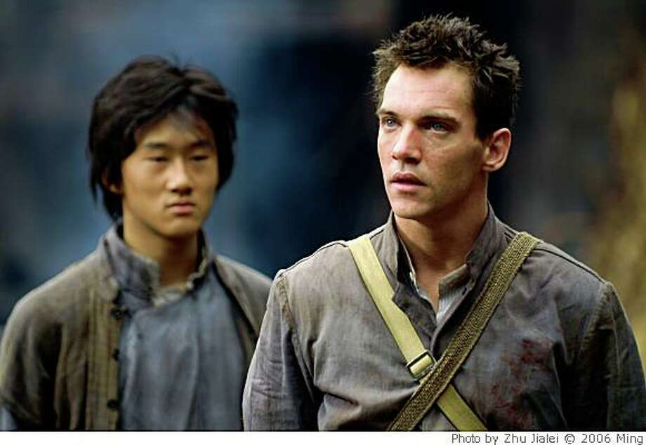 "Guang Li as Shi Kai and Jonathan Rhys Meyers as George Hogg in Roger Spottiswoode's ""THE CHILDREN OF HUANG SHI,"" a movie based on the true story of the rescue of 60 orphaned children in war-torn China during the 1930's, opening Friday May 30 in Bay Area theaters.Photo by Zhu Jialei © 2006 Ming Productions, courtesy Sony Pictures Classics. All Rights Reserved. Photo: Photo By Zhu Jialei © 2006 Ming"
