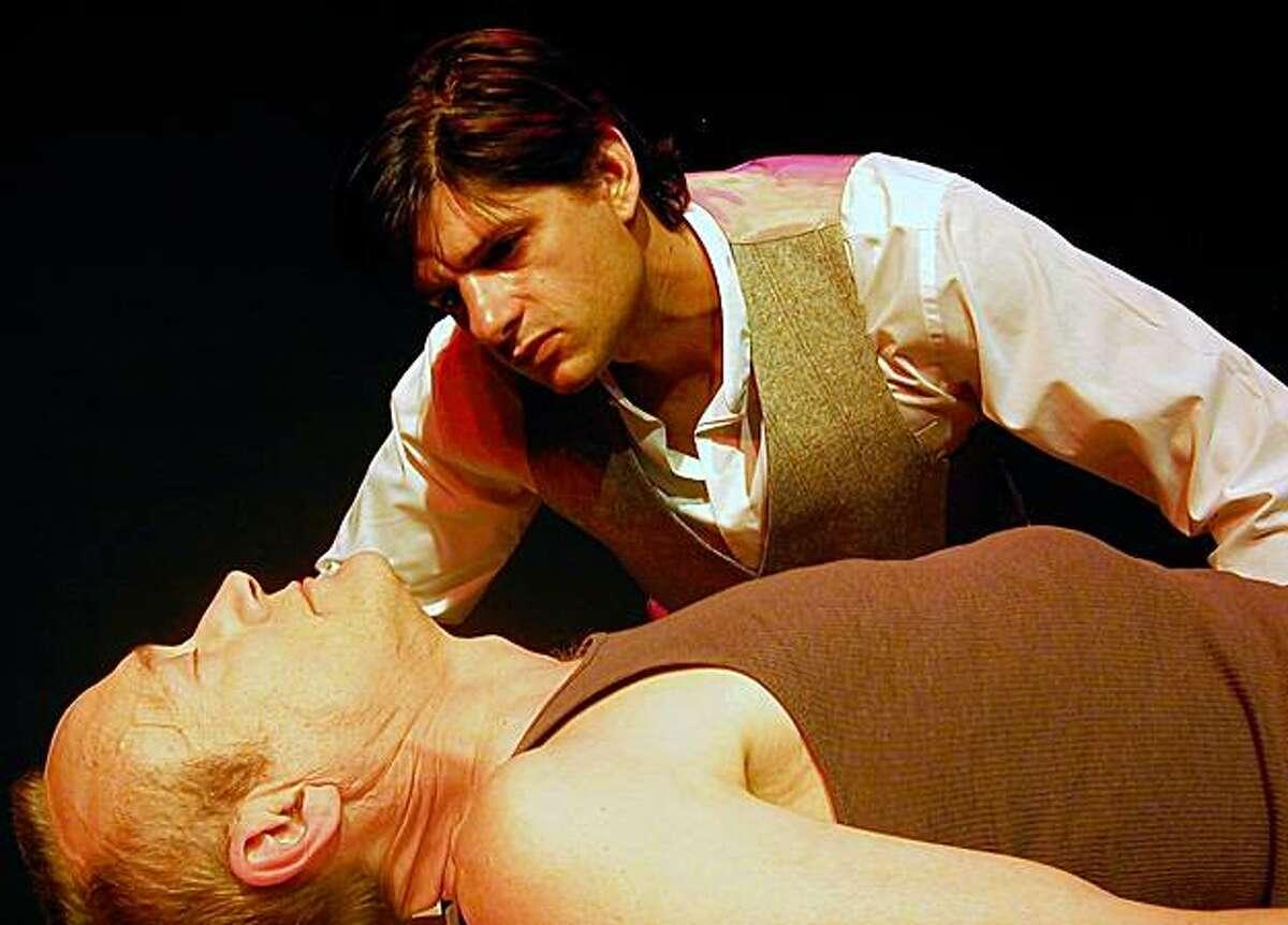 Frankenstein (standing, Gabriel Marin) observes his creation (James Carpenter) in