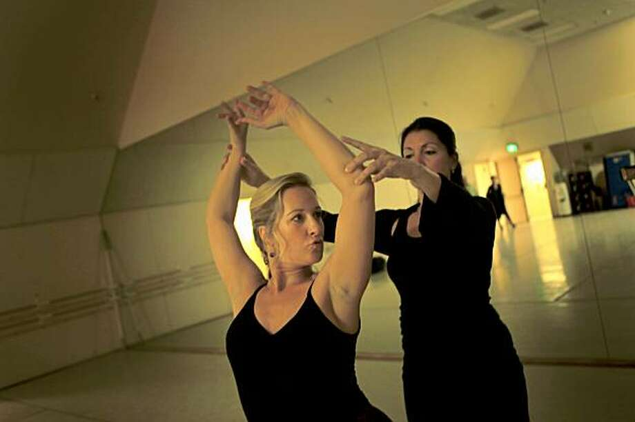 Soprano Diana Damrau (l to r) is seen in the ballet studio with La Tania, flamenco instructor and choreographer, at the War Memorial Opera House in San Francisco, Calif. on Thursday October 22, 2009. Photo: Lea Suzuki, The Chronicle