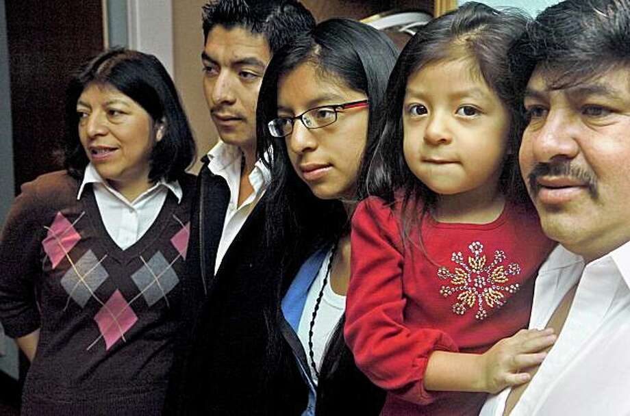 The parents of a family of five are facing deportation. From left to right, mom Elida Perez-Mazariegos, Gilbert Mejia, 18, Helen Mejia, 13, Dulce Mejia, 4 and dad Salvador Mejia, gathered in their living room on October 8, 2009, in Novato, Calif. Photo: Frankie Frost, Marin Independent Journal