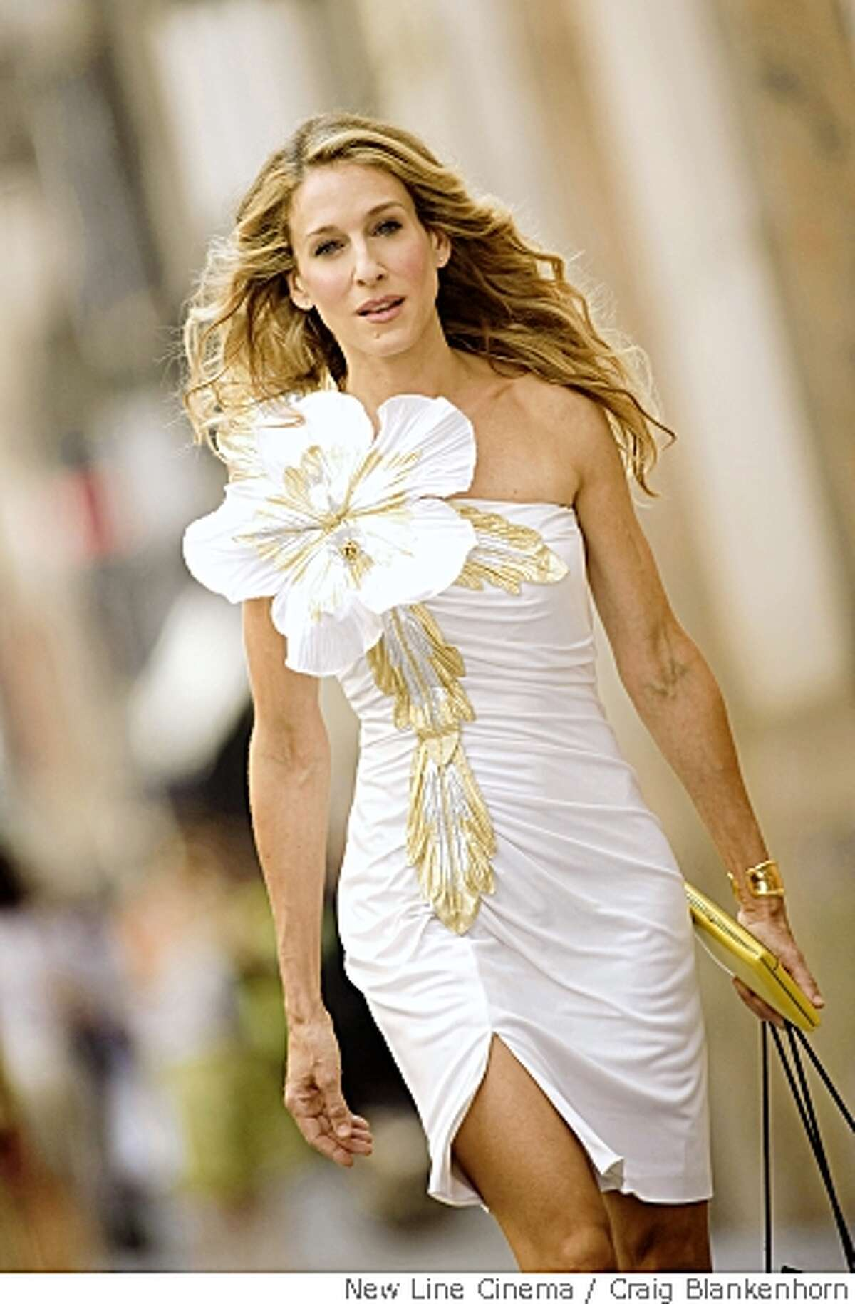 """In this image released by New Line Cinema, Sarah Jessica Parker stars as Carrie Bradshaw in New Line Cinema's """"Sex in the City"""". (AP Photo/New Line Cinema,Craig Blankenhorn) ** NO SALES **"""