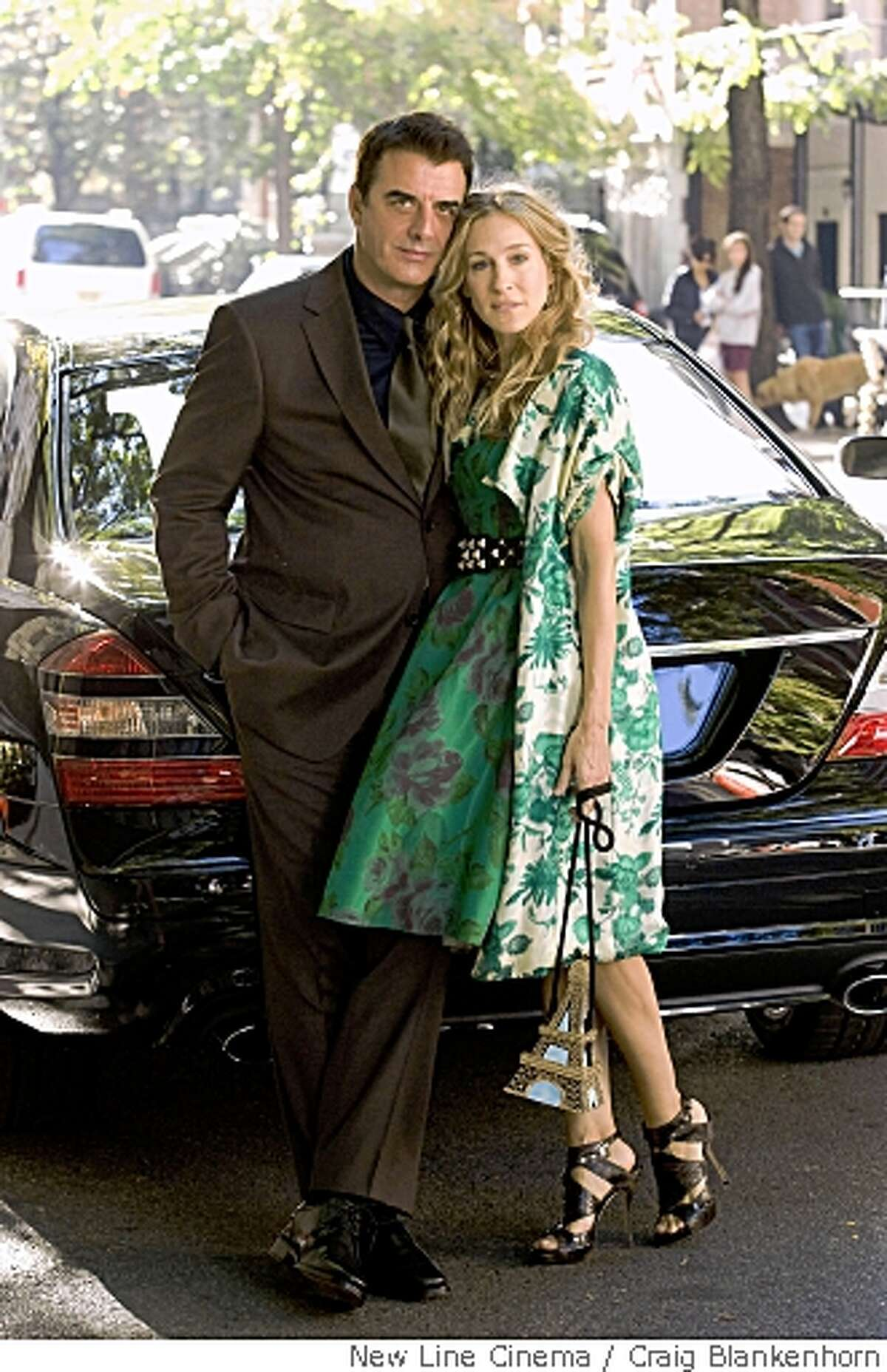 """In this image released by New Line Cinema, Chris Noth stars as Mr. Big, left, and Sarah Jessica Parker stars as Carrie Bradshaw in New Line Cinema's """"Sex in the City"""". (AP Photo/New Line Cinema,Craig Blankenhorn) ** NO SALES **"""
