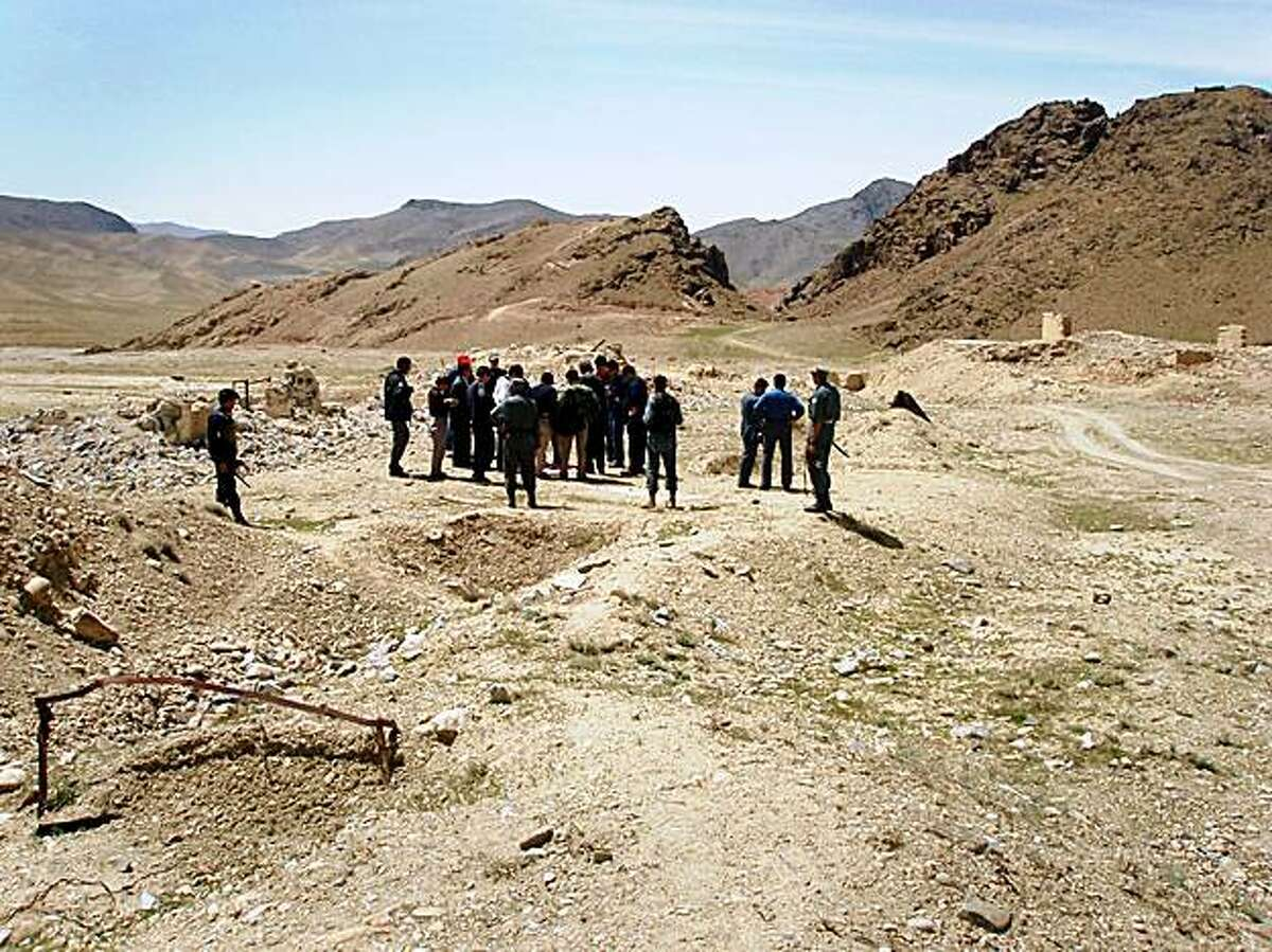 ** ADVANCE FOR SUNDAY, NOV. 1, 2009, AND THEREAFTER ** This April 2007 photo provided by James Yeager shows a delegation from the state-owned Chinese company, China Metallurgical Group Corporation, visiting the site of a copper mine in Aynak, a former al-Qaida stronghold southeast of Kabul, Afghanistan. The mounds behind the group, called