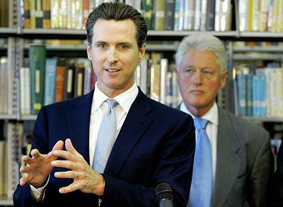 San Francisco Mayor Gavin Newsom, left, is joined by former U.S. President Bill Clinton, right, at Los Angeles City College's new Science and Technology Building to talk to faculty and students about education for green technology jobs Monday, Oct. 5, 2009, in Los Angeles. Clinton is in Los Angeles to help raise money for San Francisco Mayor Gavin Newsom's slow-starting campaign for governor. (AP Photo/Damian Dovarganes) Photo: Damian Dovarganes, AP
