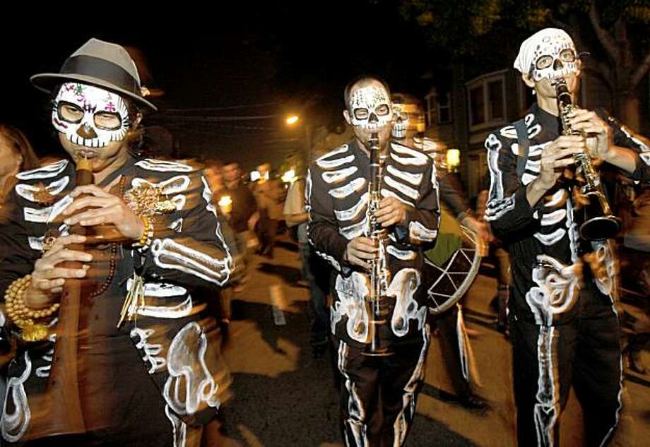 The MWE Band from San Francisco made there way through city streets during El Dia De Los Muertos procession in San Francisco, Calif. on Monday November 2, 2009. Photo: Jana Asenbrennerova, The Chronicle