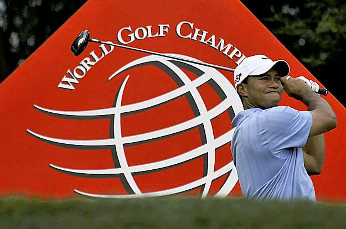 Tiger Woods of the United States watches his tee shot on the 15th hole during the HSBC Champions golf tournament in Shanghai, China, Friday, Nov. 6, 2009. Woods finished second day with the score 10 under with co-leader compatriot Nick Watney. (AP Photo/Andy Wong)