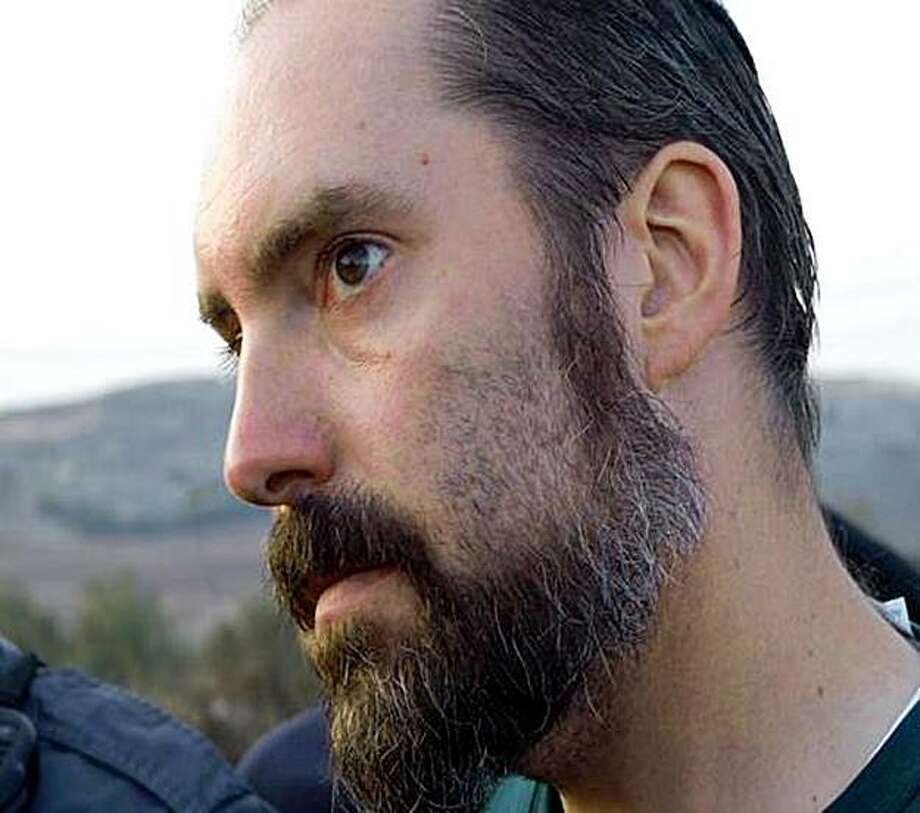 In this undated photo provided by the Israeli Shin Bet Security Service on Sunday, Nov. 1, 2009, ultra-Orthodox West Bank settler Jack Teitel, 37, is seen in an undisclosed location in Israel. Israeli authorities have apprehended Teitel, a Jewish-American extremist, suspected of carrying out a series of high-profile ideologically motivated attacks against Arabs, peace activists, and other Israelis, security officials said Sunday. (AP Photo, Shin Bet Security Service) Photo: Shin Bet Security Service, AP