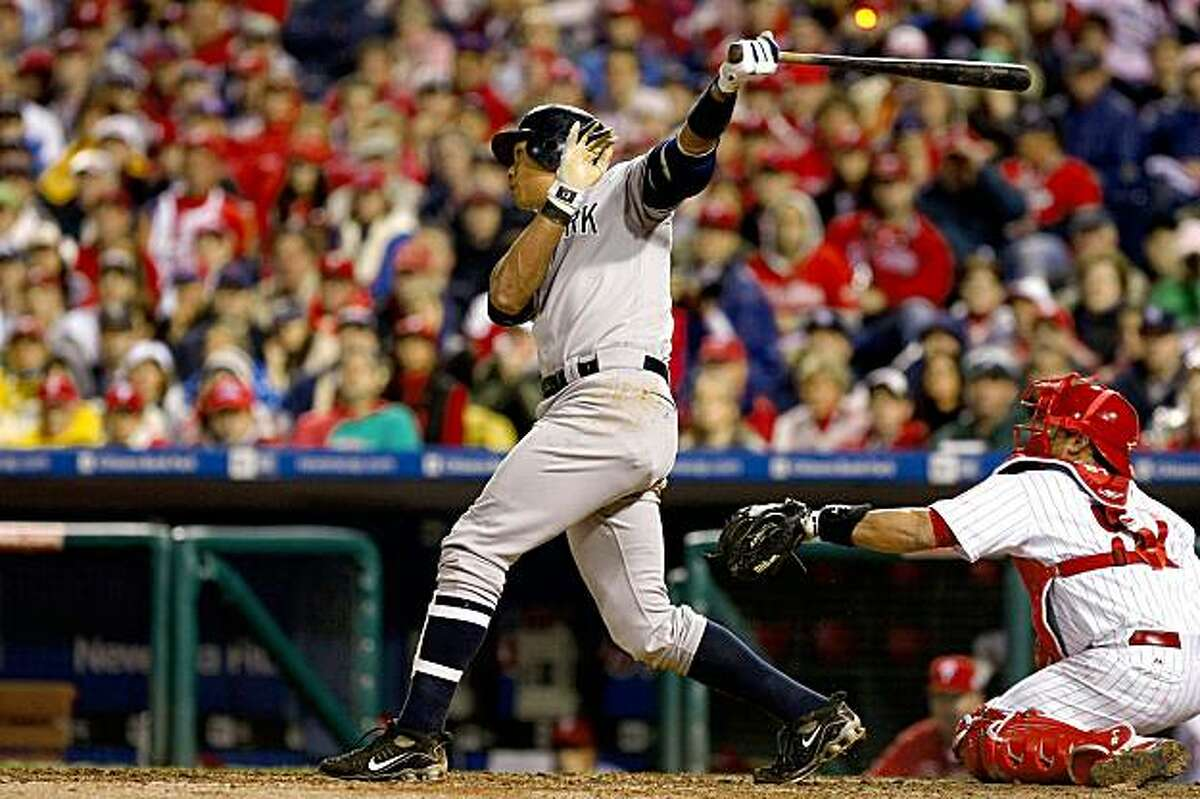PHILADELPHIA - OCTOBER 31: Alex Rodriguez #13 of the New York Yankees hits a two-run home run against the Philadelphia Phillies in Game Three of the 2009 MLB World Series at Citizens Bank Park on October 31, 2009 in Philadelphia, Pennsylvania. (Photo by Chris McGrath/Getty Images)