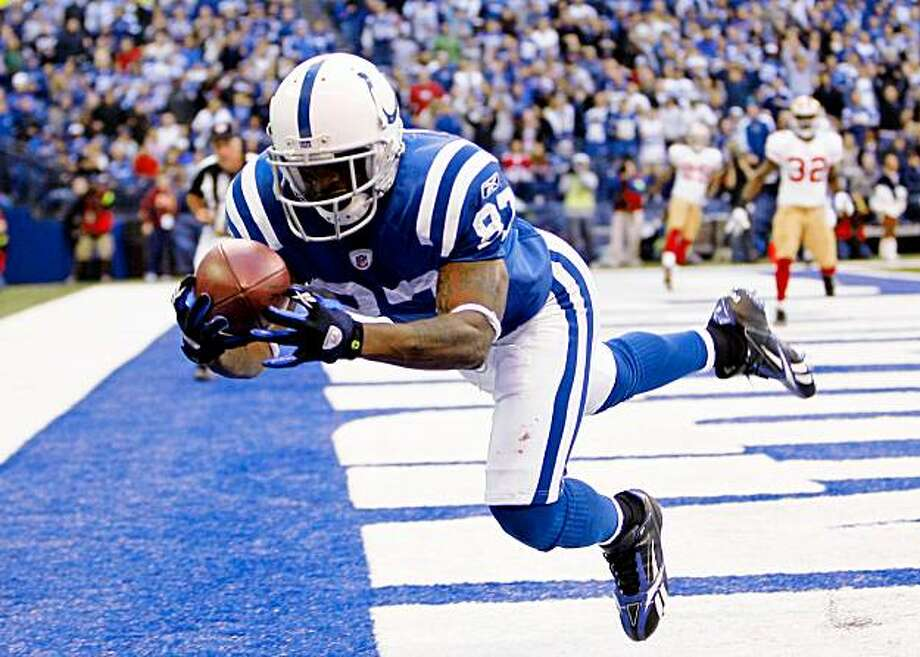 INDIANAPOLIS - NOVEMBER 01: Reggie Wayne #87 of the Indianapolis Colts catches a touchdown pass during the NFL game against the San Francisco 49ers at Lucas Oil Stadium on November 1, 2009 in Indianapolis, Indiana.  (Photo by Andy Lyons/Getty Images) Photo: Andy Lyons, Getty Images
