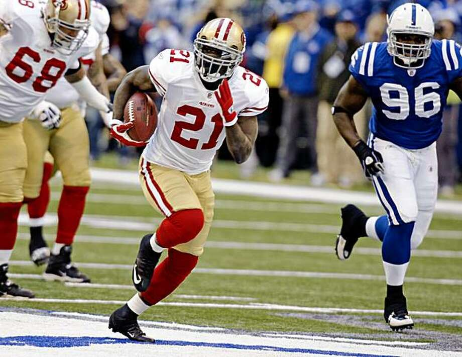 San Francisco 49ers running back Frank Gore (21) gets past Indianapolis Colts defensive tackle Keyunta Dawson, right, on the way to a 63-yard touchdown in the first quarter of an NFL football game in Indianapolis, Sunday, Nov. 1, 2009. (AP Photo/Michael Conroy) Photo: Michael Conroy, AP