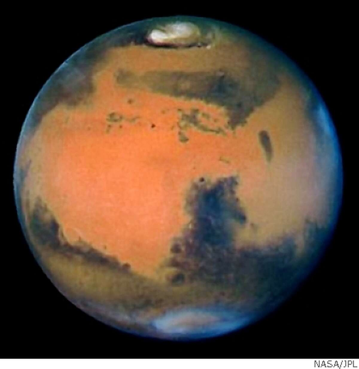 The sharpest view of Mars ever taken from Earth was obtained by the NASA Hubble Space Telescope (HST). This stunning portrait was taken with the HST Wide Field Planetary Camera-2 (WFPC2) on March 10, 1997, just before Mars opposition, when the red planet made one of its closest passes to the Earth (about 60 million miles or 100 million km).