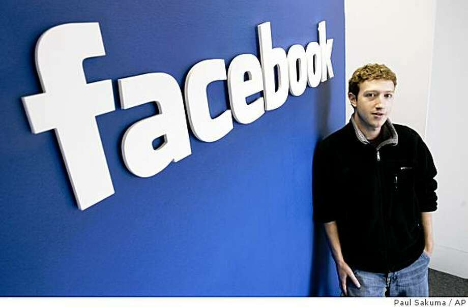 Facebook founder and CEO Mark Zuckerberg poses at Facebook headquarters in Palo Alto, Calif., Feb. 5, 2007. In an about-face following a torrent of online protests, Facebook is backing off a change in its user policies while it figures how best to resolve questions like who controls the information shared on the social networking site. (AP Photo/Paul Sakuma) Photo: Paul Sakuma, AP