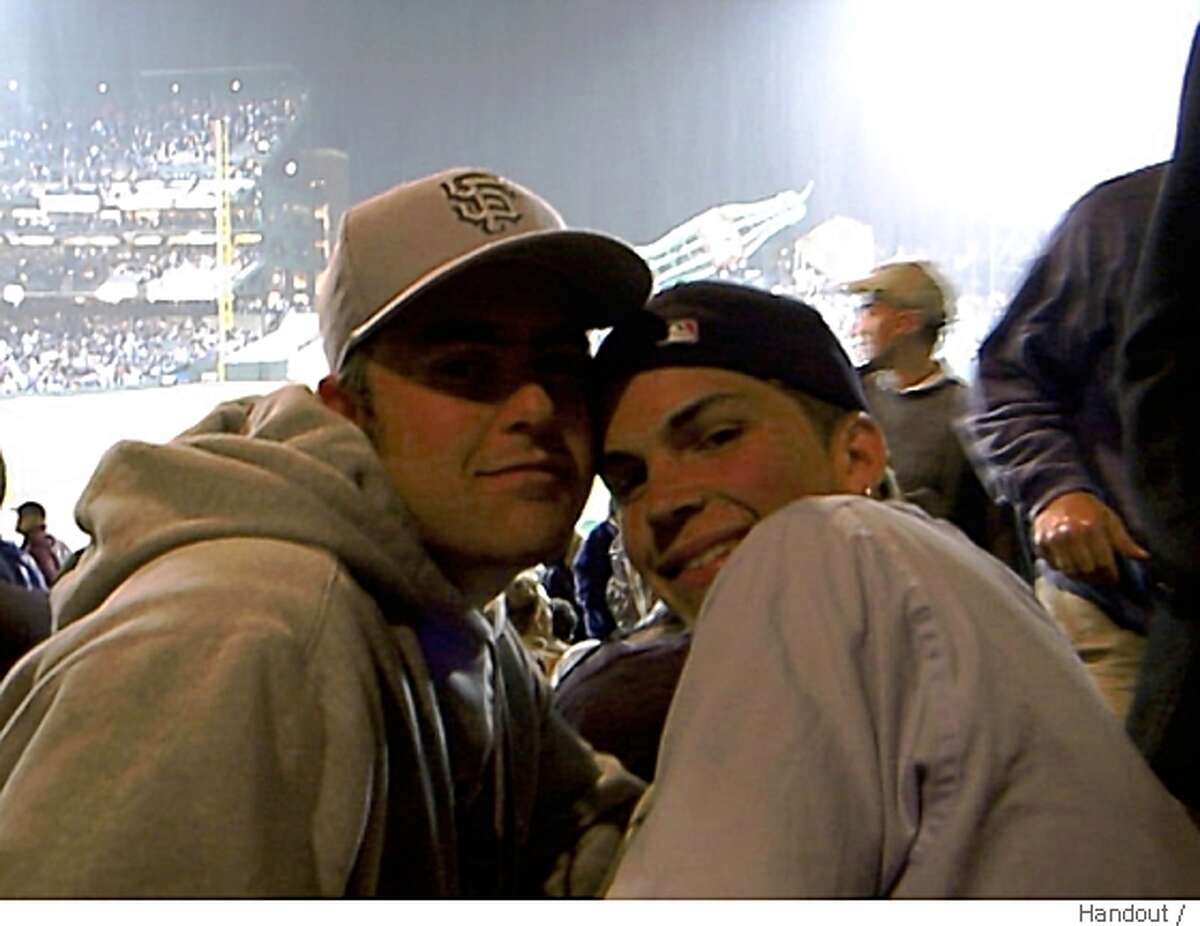 Timothy Griffith (right), shown with brother Josh at a game in 2000, was killed after Friday night's game against the Padres.