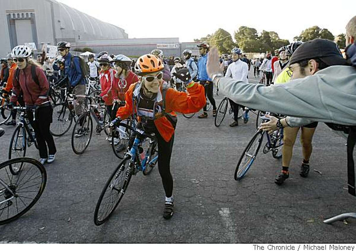Liz Wright of Hollywood gets a high-five from a stranger as she starts her first AIDS/ Lifecycle 7-Day 545 mile ride to support HIV/AIDS. The riders started at the Cow Palace in San Francisco, Calif. on June 1, 2008 and will finish on Saturday June 7 in Los Angeles.