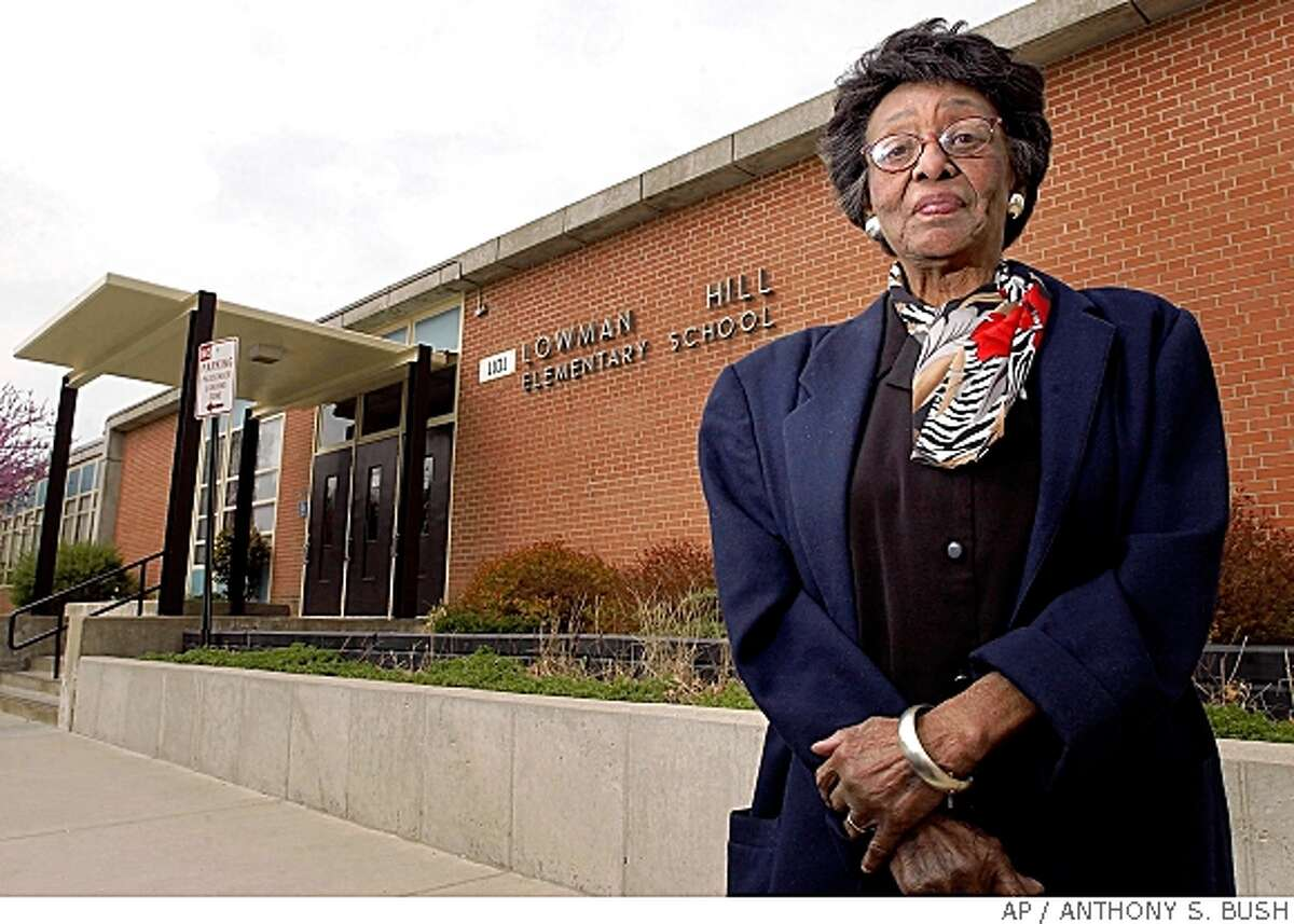 ** FILE ** In this May 1, 2004 file photo Zelma Henderson, the last surviving plaintiff in Topeka's Brown v. Board of Education case, stands outside Lowman Hill Elementary School, in Topeka, Kan. Lowman Hill, the first integrated school in Topeka, was the first school Henderson's children attended after the ruling came down. Henderson died Tuesday May 20, 2008 in Topeka. She was 88. (AP Photo/Topeka Capital Journal, Anthony S. Bush, File)