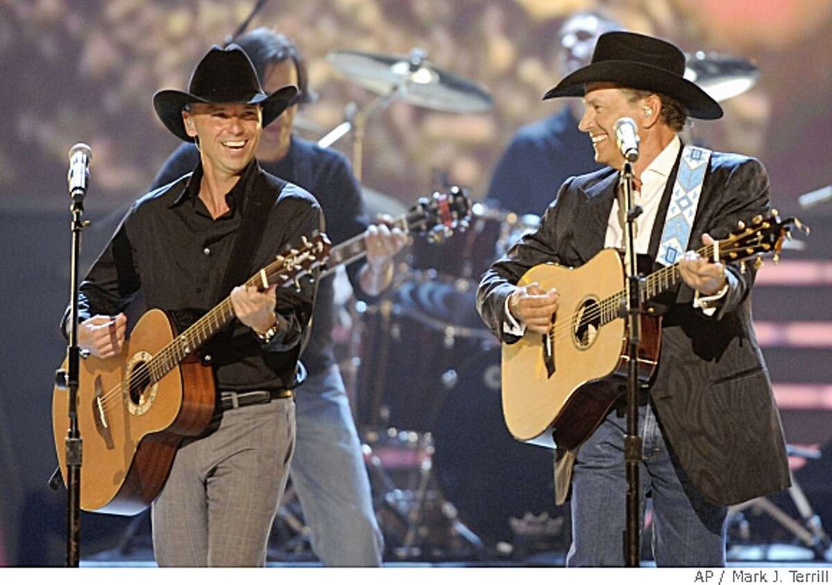 Kenny Chesney, left, and George Strait perform at the 43rd Annual Academy of Country Music Awards on Sunday, May 18, 2008, in Las Vegas. (AP Photo/Mark J. Terrill)
