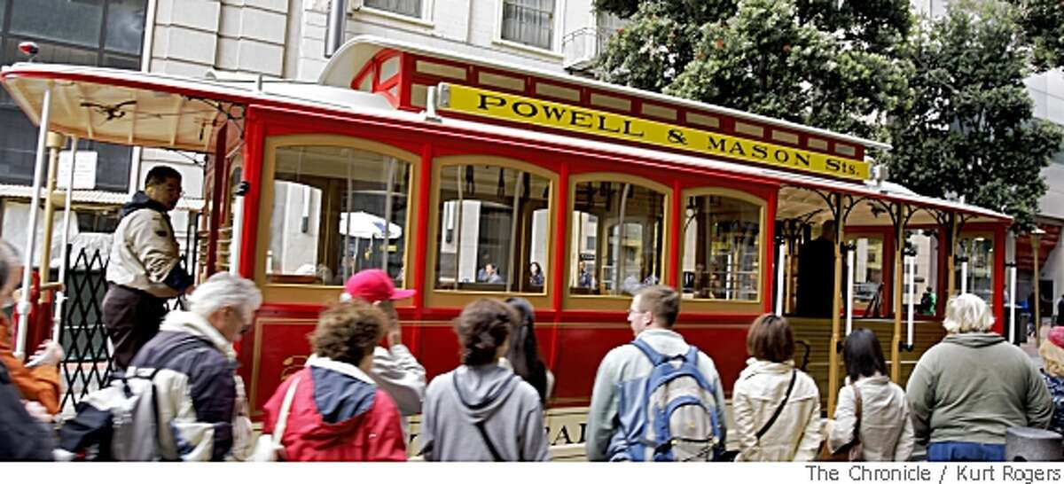 Passengers wait to board San Francisco cable car No. 25, which was taken out of service for an extensive refurbishing over nearly two years, at the Powell Street turnaround. Chronicle photo by Kurt Rogers