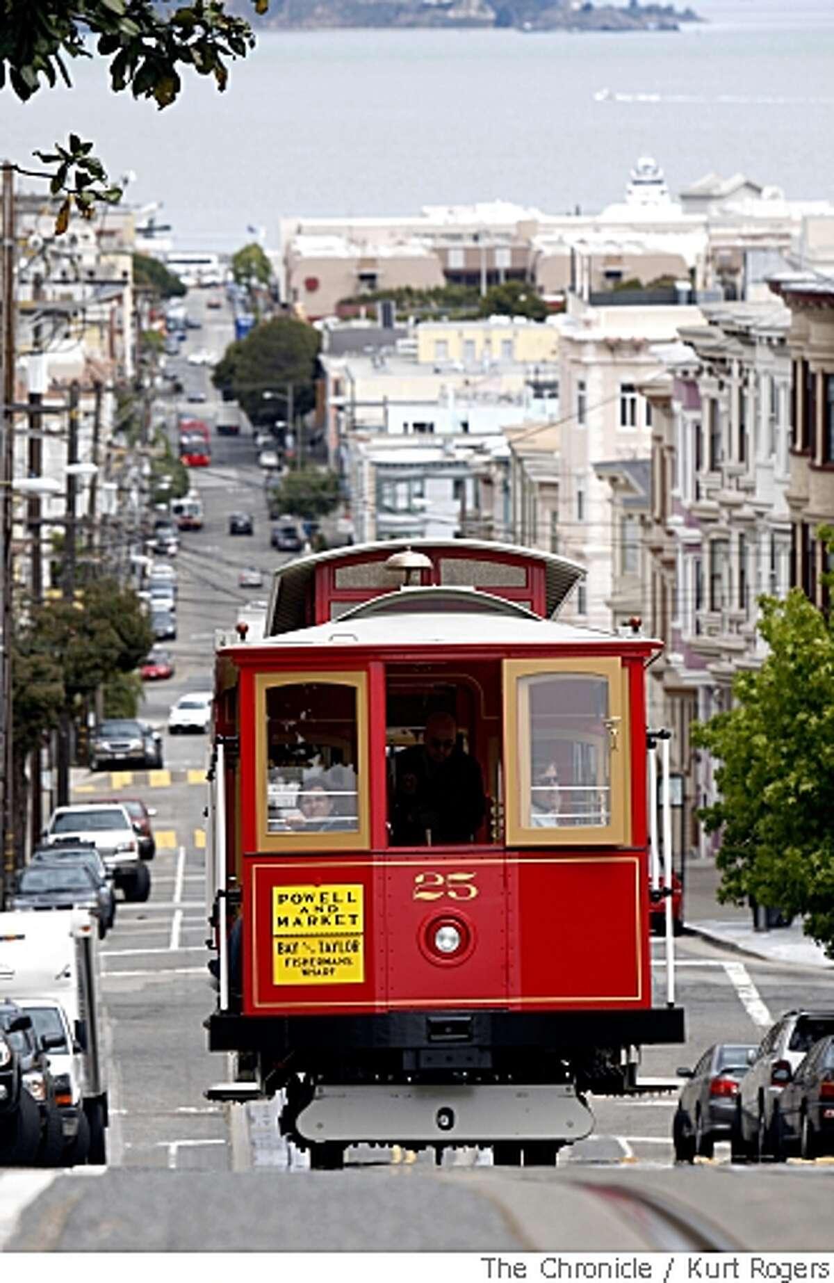 San Francisco cable car No. 25 makes its way up Mason street. Chronicle photo by Kurt Rogers
