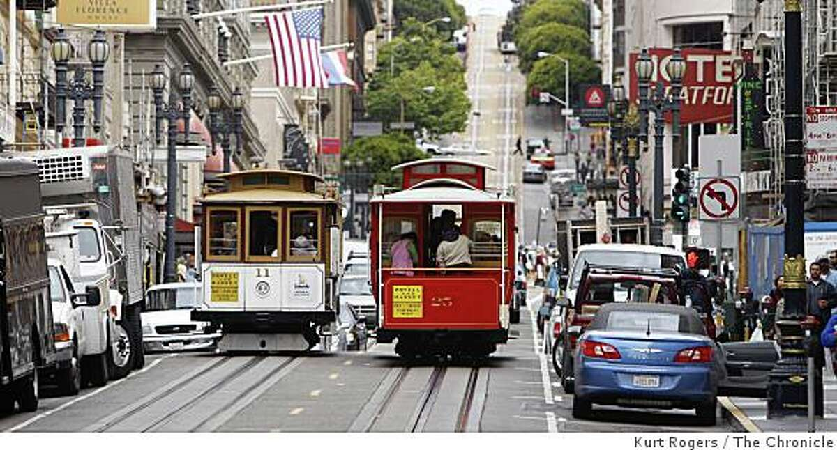 San Francisco cable car No. 25 passes cable car No. 11 as it heads up Powell Street. Chronicle photo by Kurt Rogers