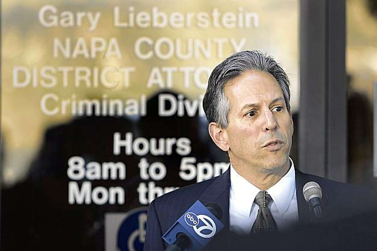 Napa County district attorney Gary Lieberstein makes the announcement that his office will not bring criminal charges against Oakland Raiders head coach Tom Cable outside his office in Napa, Calif., Thursday, Oct. 22, 2009. Cable won't face charges after being investigated over allegations that he assaulted one of his assistants, ending a two-month saga that was a cloud over the team's season. Lieberstein said Thursday that the investigation concluded no charges were warranted. (AP Photo/Napa Valley Register, J.L. Sousa)