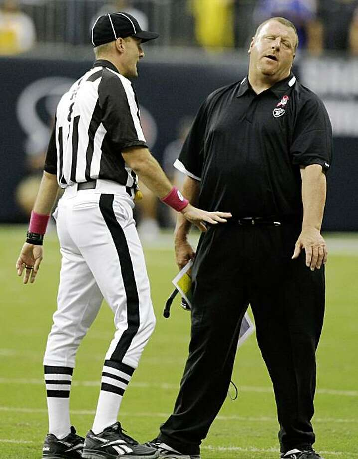 Oakland Raiders head coach Tom Cable, right, reacts after trying to argues a call with an official during the 2nd quarter of an NFL football game against the Houston Texans at Reliant Stadium Sunday, Oct. 4, 2009, in Houston. The Texans beat the Raiders 29-6. Photo: Brett Coomer, Hearst Newspapers