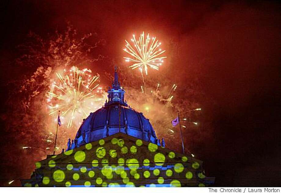 Fireworks go off behind City Hall during the Black and White Ball in San Francisco. Photo: Laura Morton, The Chronicle
