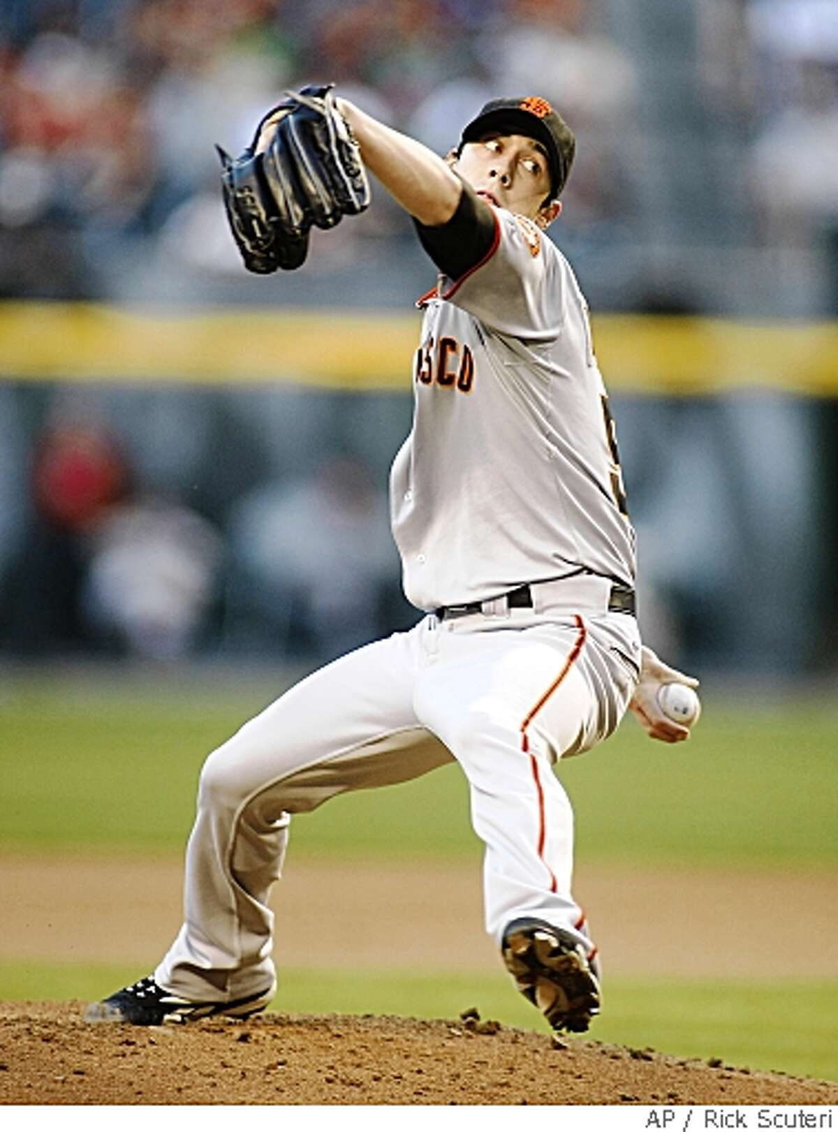 San Francisco Giants pitcher Tim Lincecum throws against the Arizona Diamondbacks in the first inning during a National League baseball game on Tuesday, May 27, 2008, in Phoenix. (AP Photo/Rick Scuteri)