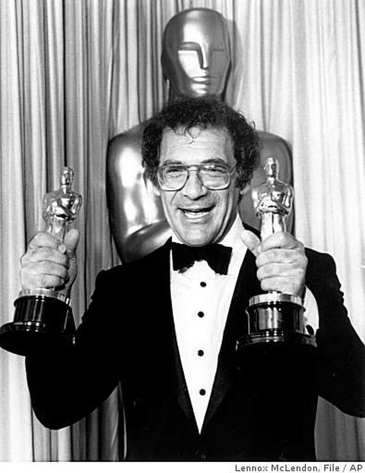 "In this March 25, 1986 file photo, Sydney Pollack holds his two Oscars at the Academy Awards in Los Angeles.  Pollack won  best director for ""Out of Africa,"" which he also produced and won best picture of the year. Photo: Lennox McLendon, File, AP"