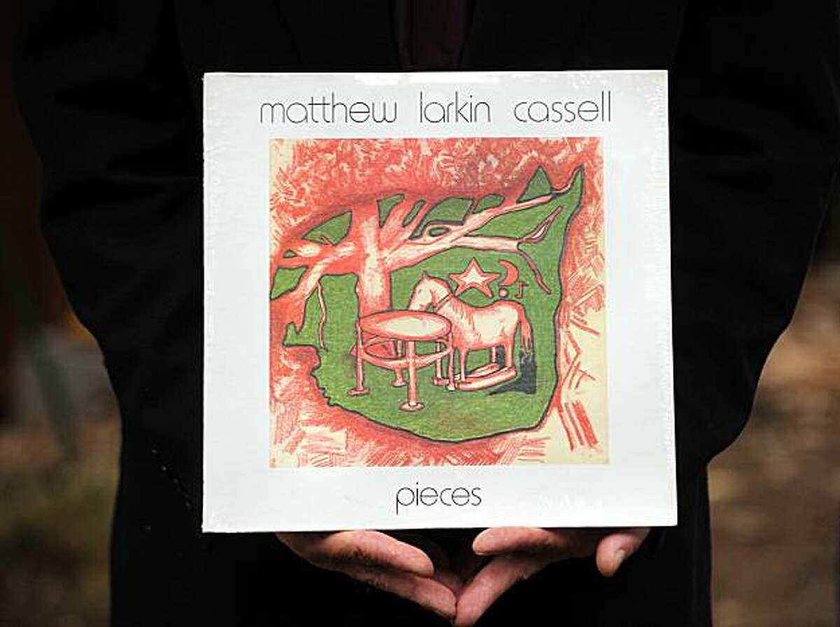Matthew Cassell holds a copy of his album