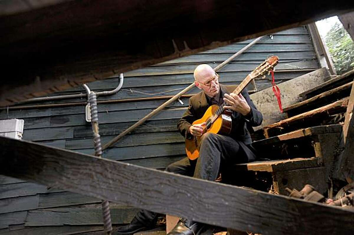 Matthew Cassell plays guitar outside his Mill Valley, Calif., home, on Friday, Oct. 9, 2009.