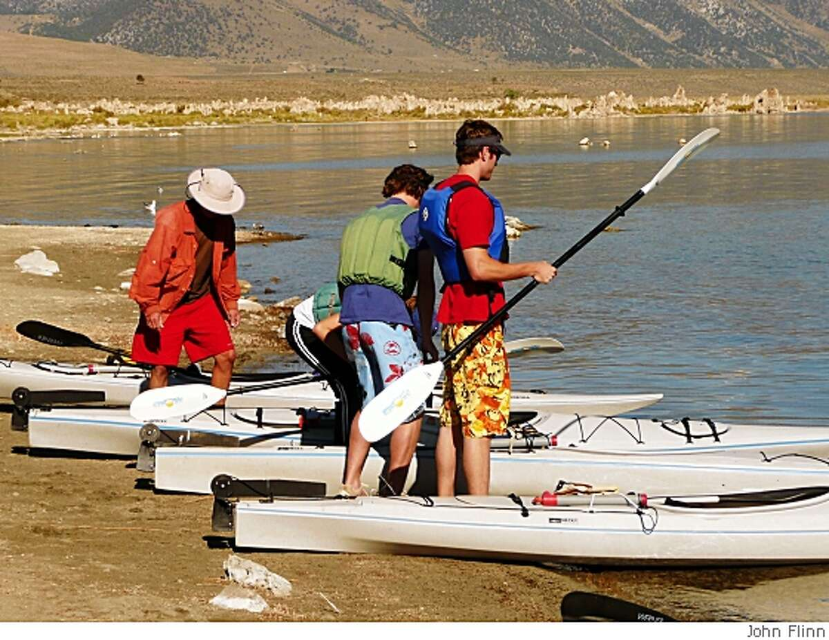 Kayakers gear up on Mono Lake's South Beach for a paddling tour of the lake.