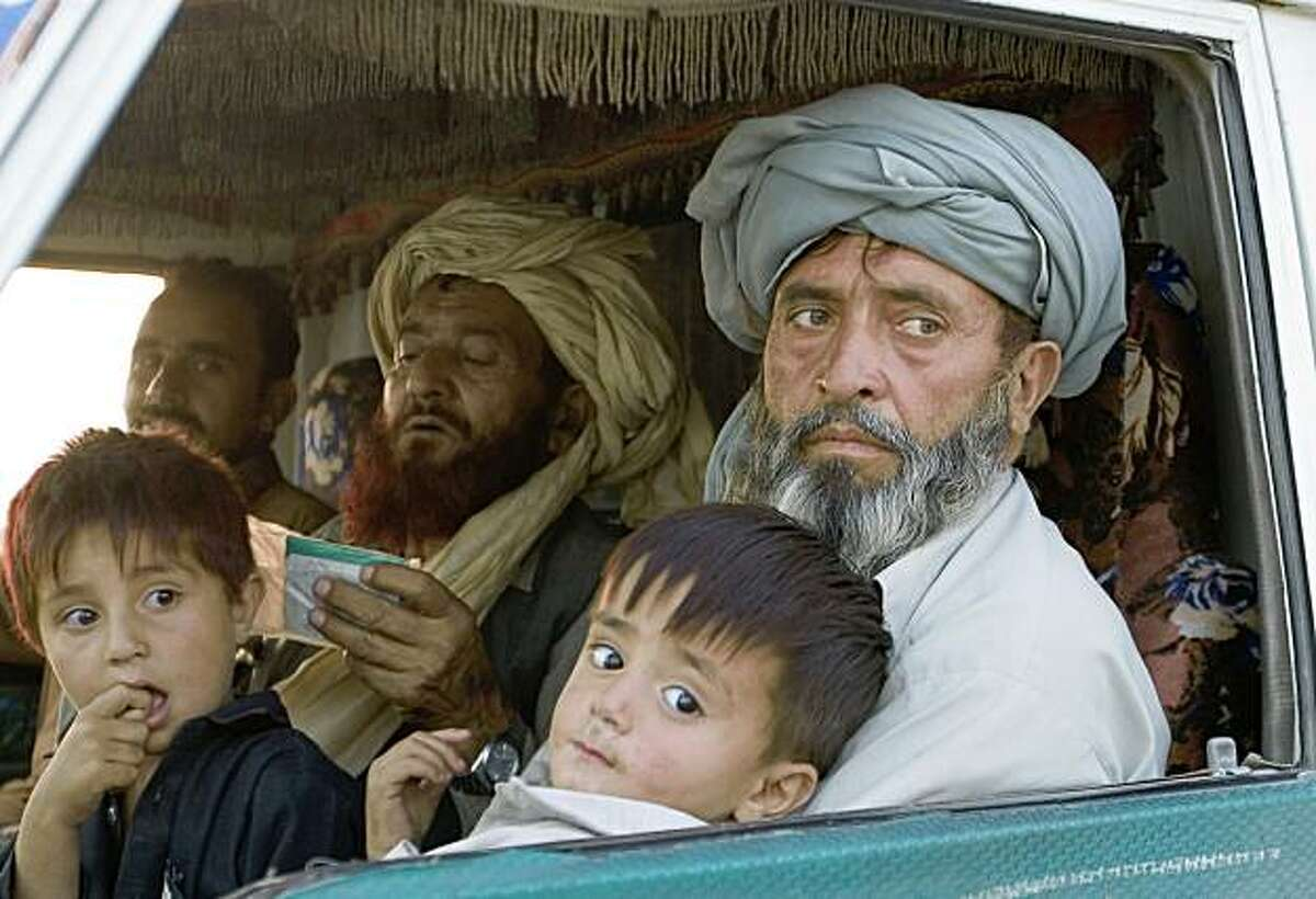 Pakistani displaced families who fled Waziristan due to the fierce fight between security forces and militants, arrive in Dera Ismail Khan, Pakistan on Wednesday, Oct. 21, 2009 . Pakistani troops and the Taliban fought fierce battles in Waziristan, a militant sanctuary near the Afghan border in an operation that started on Saturday, with both sides claiming early victories in an army campaign that could shape the future of the country's battle against extremism. (AP Photo/B.K.Bangash)