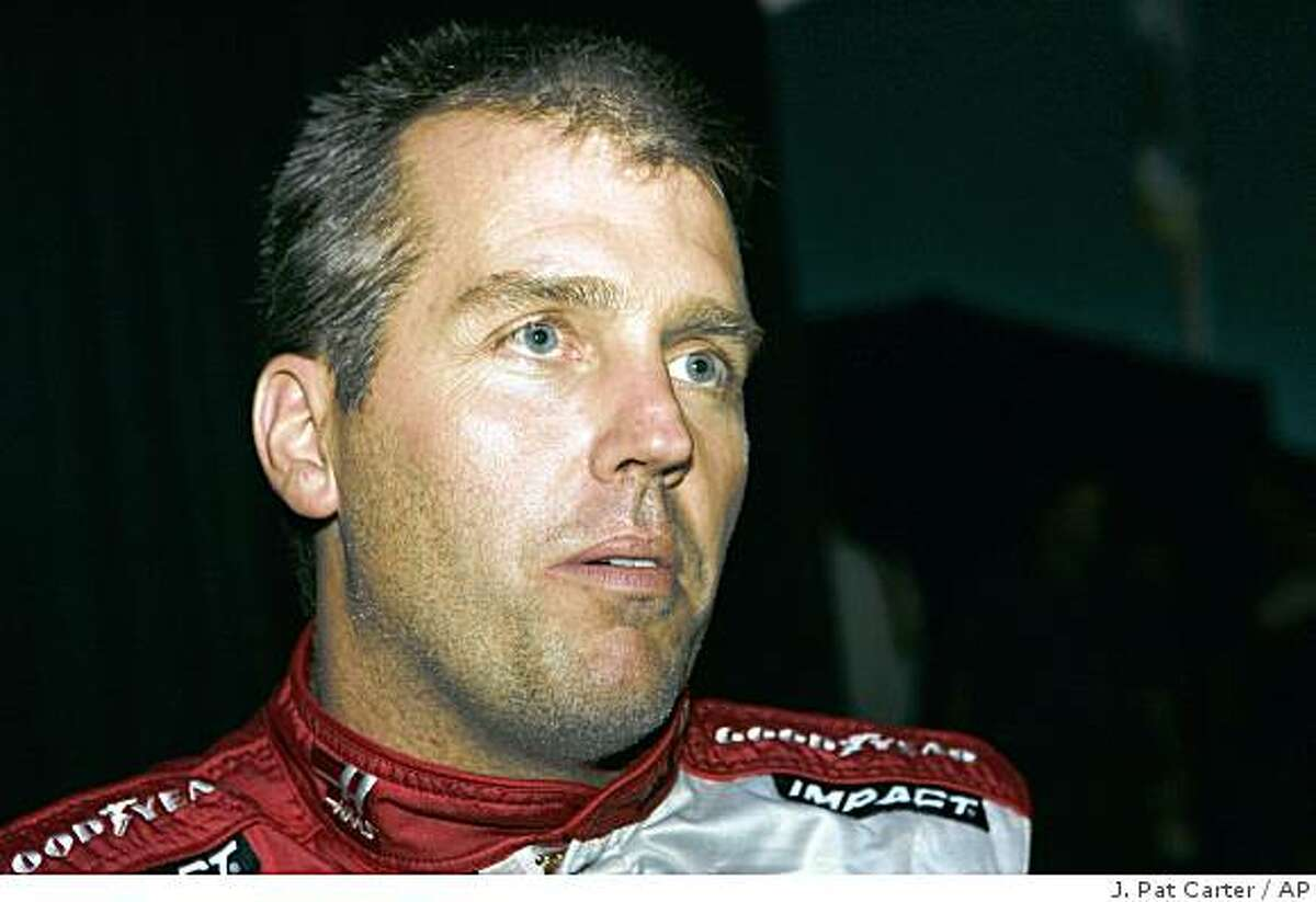FILE - In this Feb. 7, 2008, file photo, NASCAR driver Jeremy Mayfield poses for photos at media day in Daytona Beach, Fla. Mayfield has been suspended indefinitely after failing a random drug test. (AP Photo/J. Pat Carter, File)