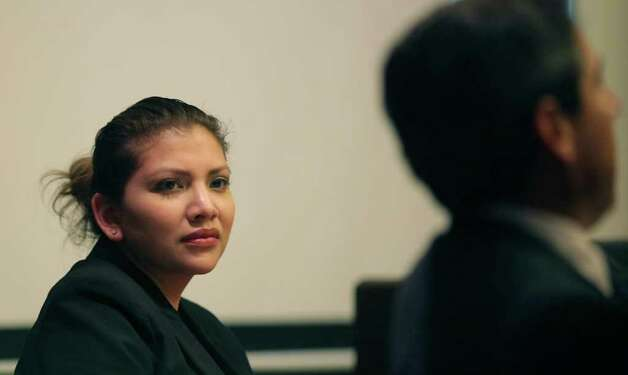 Defendant Jenny Ybarra looks toward her lawyer, Roy Barrera Jr., as he speaks to the court Thursday. Photo: Bob Owen, San Antonio Express-News / © 2012 San Antonio Express-News