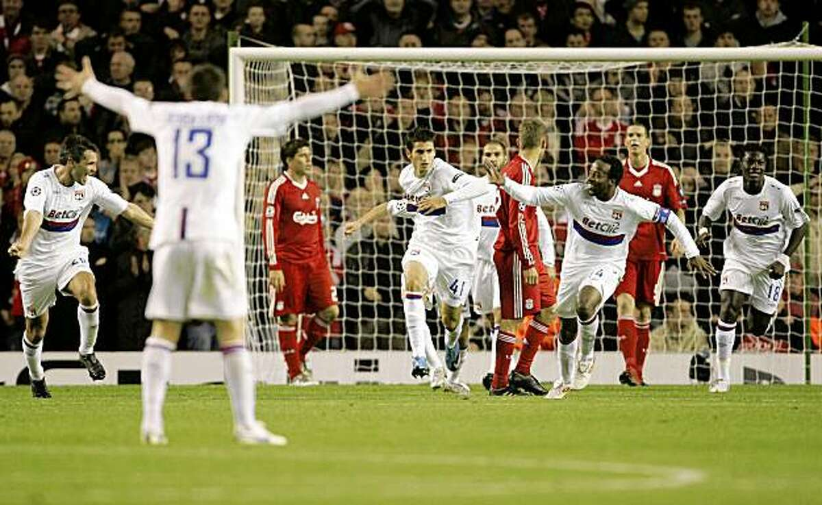 Lyon's Maxime Gonalons, center left, reacts with fellow team members after scoring against Liverpool during their Champions League group E soccer match at Anfield Stadium, Liverpool, England, Tuesday Oct. 20, 2009. (AP Photo/Tim Hales)