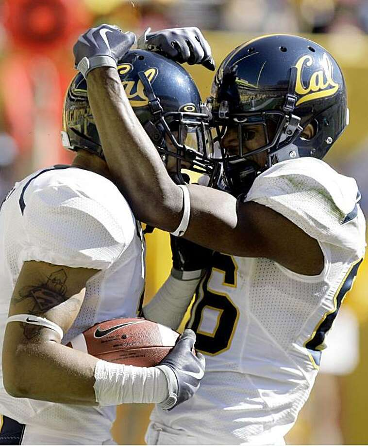 California wide receiver Marvin Jones, left, celebrates with teammate Verran Tucker, right, after Jones made a touchdown reception against Arizona State in the first quarter of an NCAA college football game Saturday, Oct. 31, 2009, in Tempe, Ariz. (AP Photo/Paul Connors) Photo: Paul Connors, AP