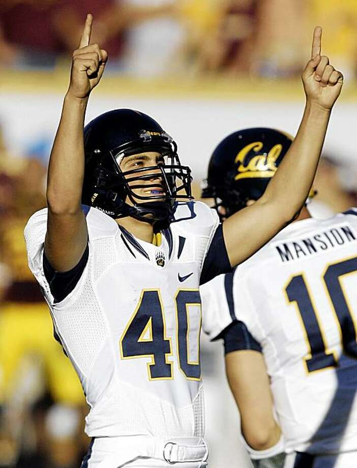 California place kicker Giorgio Tavecchio celebrates his game-winning field goal with 21 second left in the fourth quarter to defeat Arizona State in an NCAA college football game Saturday, Oct. 31, 2009, in Tempe, Ariz. California won 23-21. (AP Photo/Paul Connors) Photo: Paul Connors, AP