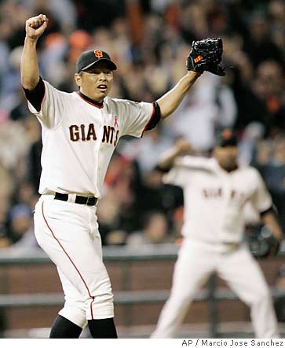 ** CORRECTS PLAY MADE TO A TRIPLE PLAY NOT A DOUBLE PLAY ** San Francisco Giants relief pitcher Keiichi Yabu, of Japan, celebrates after getting San Diego Padres' Kevin Kouzmanoff to ground out for an inning-ending triple play in the eighth inning of a baseball game in San Francisco, Friday, May 30, 2008.(AP Photo/Marcio Jose Sanchez)